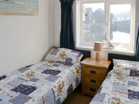 The second bedroom in Nightingale Cottage, with twin beds