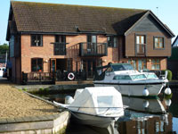 Yare Cottage shown from across the marina